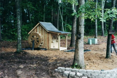 Water_wheel_and_playhouse_for_goldfish_pond